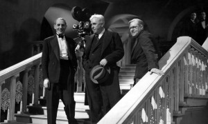 Jack Hulbert (left) with Mack Sennett (center), visiting the set, and director Walter Forde