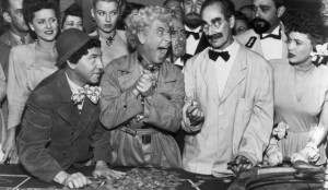 "Groucho offers Harpo some brotherly advice: ""Remember what happened in 1929?"""