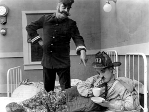 Eric Campbell and Chaplin in The Fireman (1916)