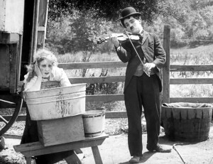 Charlie serenades Edna Purviance in The Vagabond.