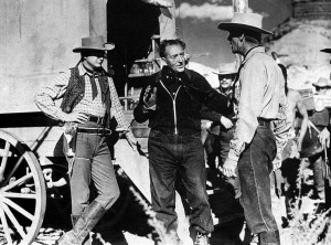 Robert Young, Fritz Lang and Randolph Scott during the filming of Western Union.